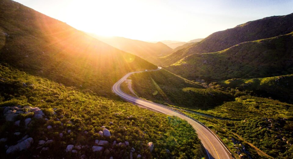 sun shining on road, by Matt Howard via Unsplash